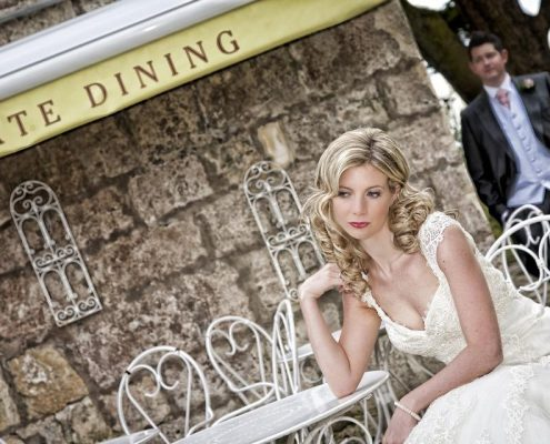 Bride in thought with natural curls and make-up
