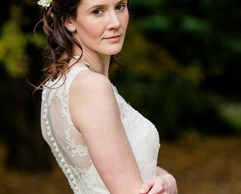 Bride with plaited wedding hair and natural make-up