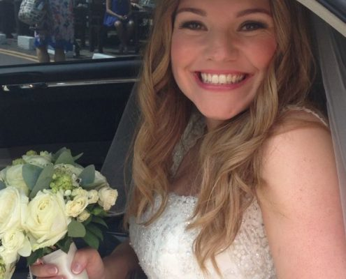 Radiant bride on the way to her wedding