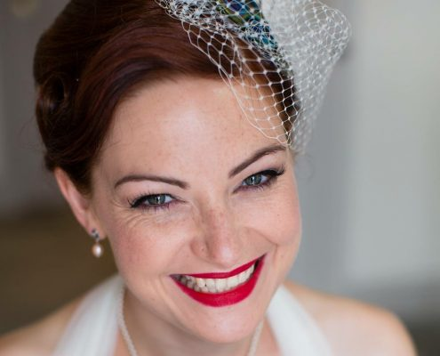 Smiling bride with vintage style hair and make-up