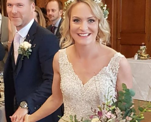 Just married: bride with flowers in her hair