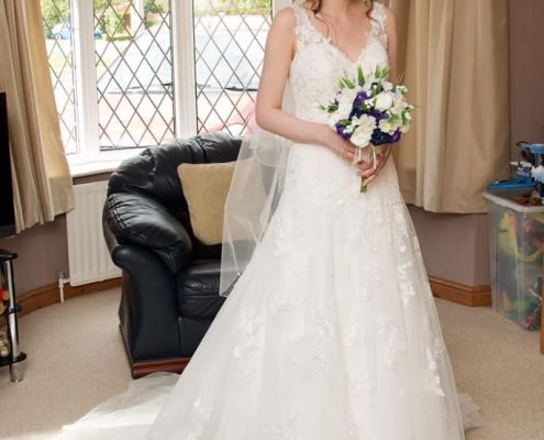 Bride at home after a bridal hair and makeup package