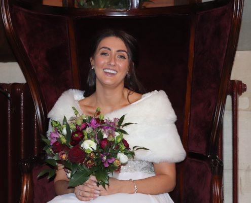 Smiling winter bride