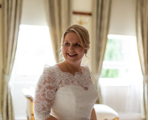 Beautiful bride with her wedding hair and makeup done